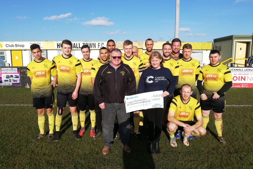 Yellows raise £1000 for Cancer Research