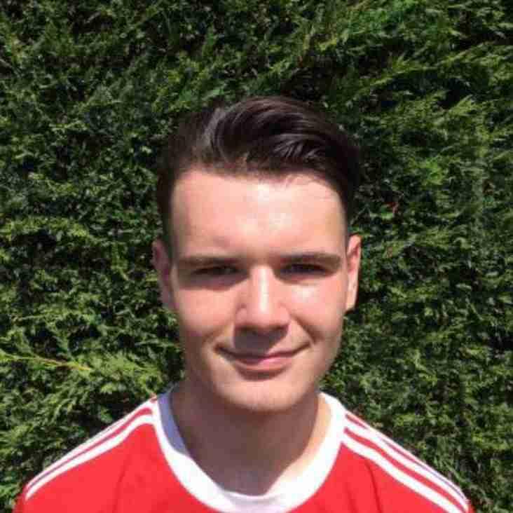 Scott McHarrie signs for Llandudno