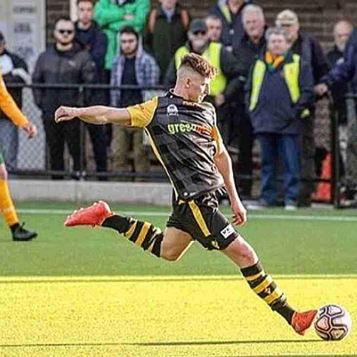 Glossop North End add defender