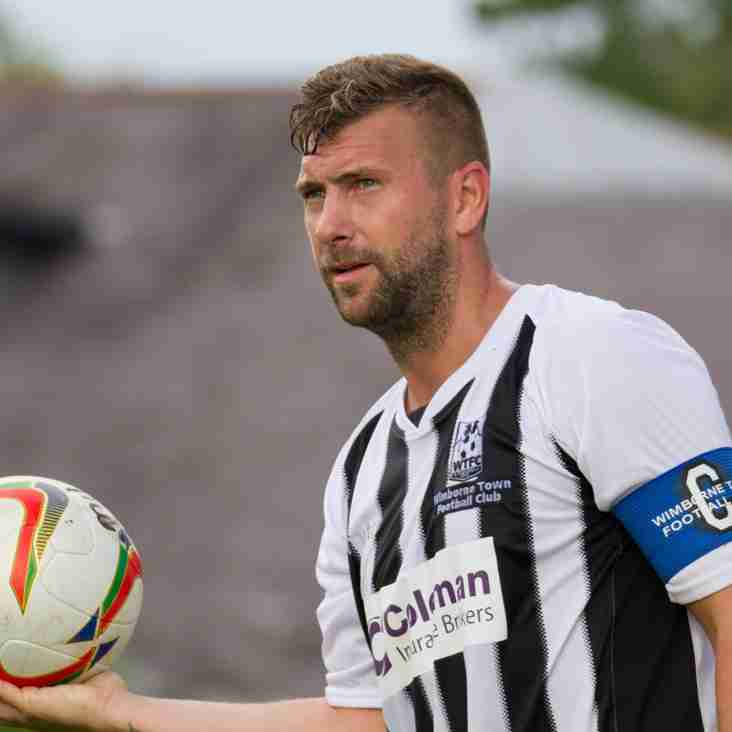Boss Matty Holmes wants Wimborne Town skipper Scott Arnold to be 'sensible'