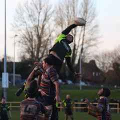 League leaders win in the sun  12-31. See the reports and picture links for the whole story.