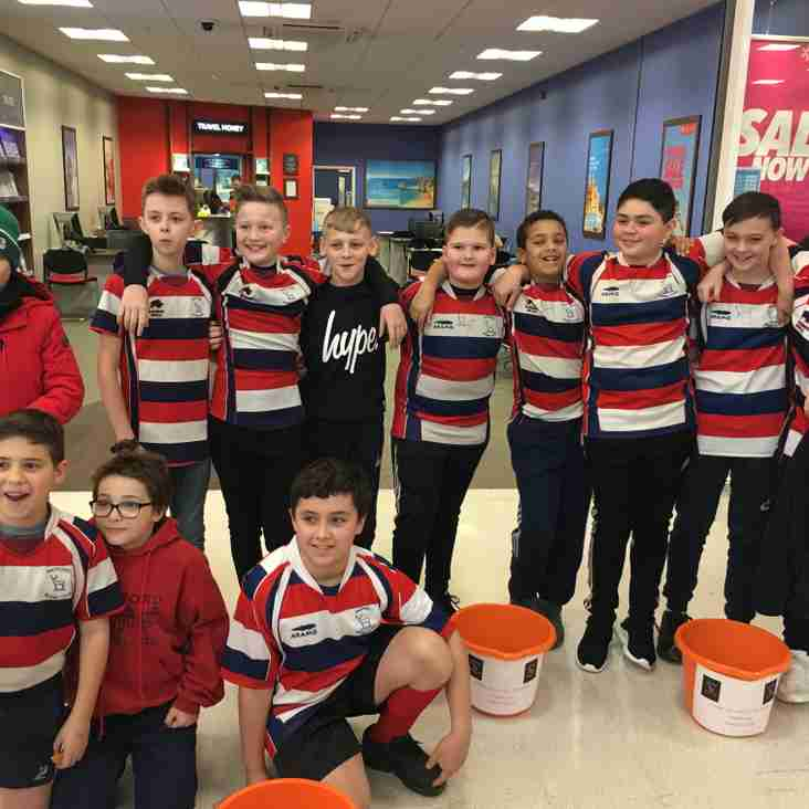 U12s fundraising at Asda Watford