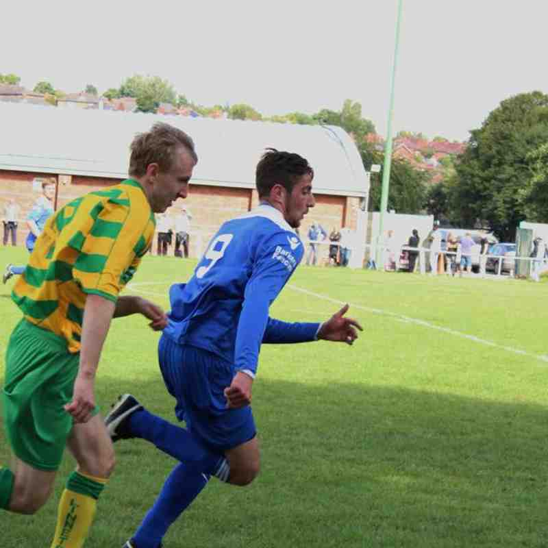 Danny cawley chases the ball with a Runcorn player