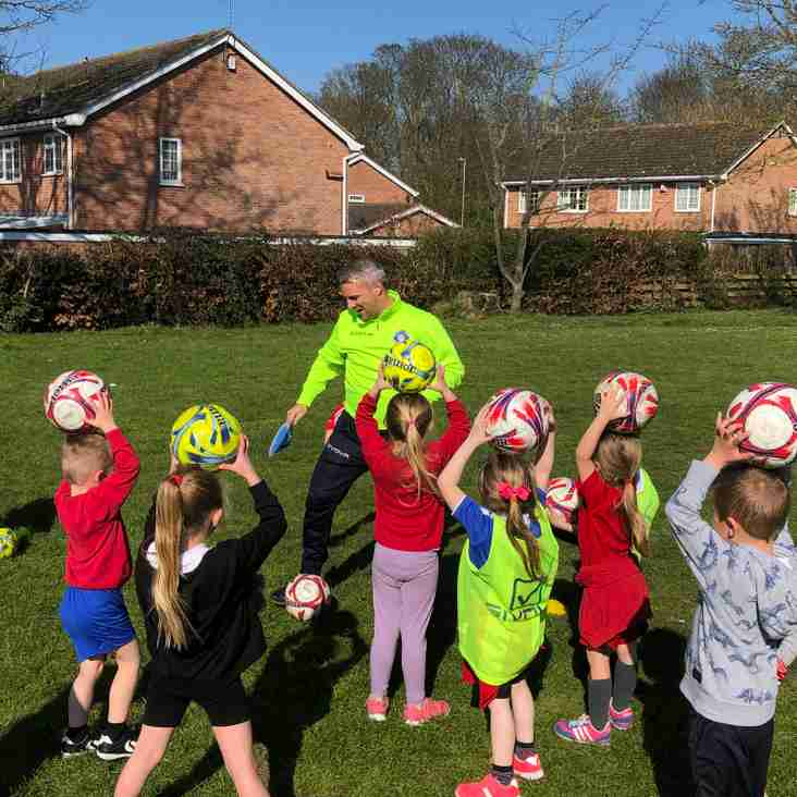 Community | Godders drops in at Gunton Primary