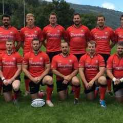 Men of Harlech prevail in blustery battle