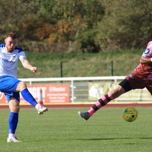 Town ease up to fourth place