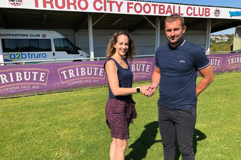 NEW MANAGER: Manager Paul Wotton signs for Truro City