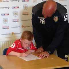 U8s player Daniel Wallis signs contract at Crewe Alexandra Academy