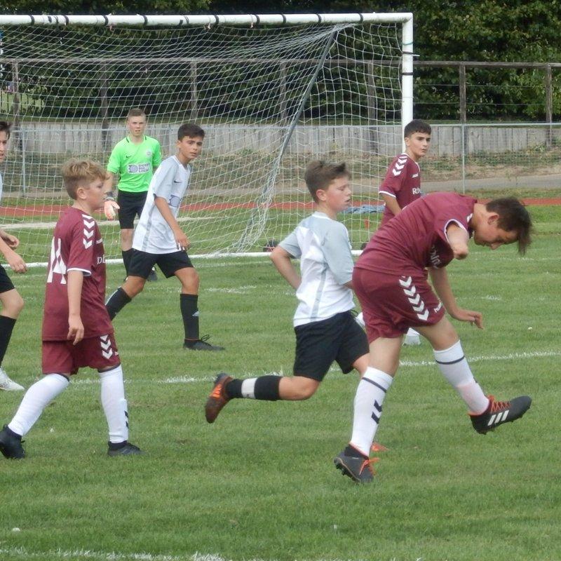 U.13 Battling Performance Against League Favourites