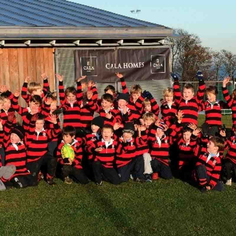 Primary 1 and 2 minis celebrate Cala Sponsorship