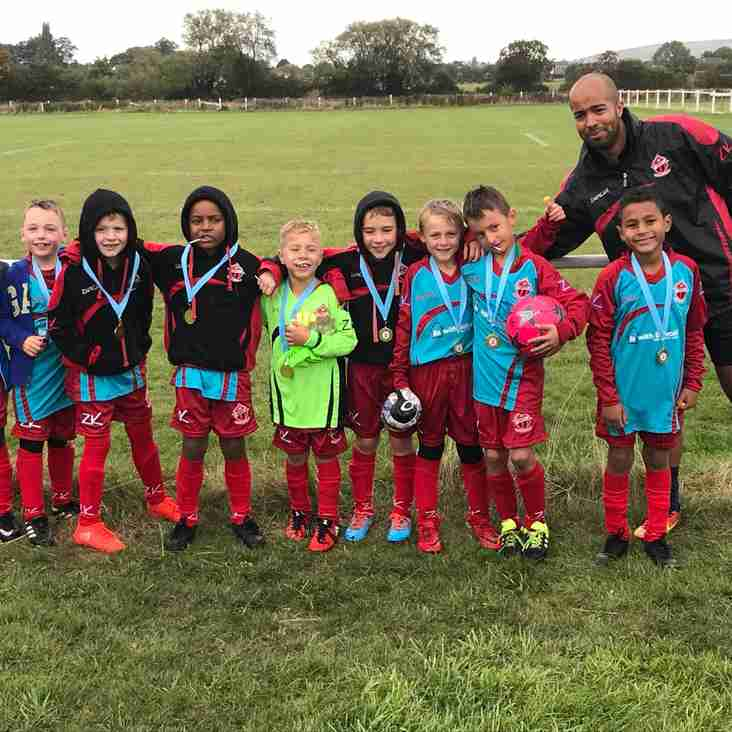 U8 Reds success in the Rain