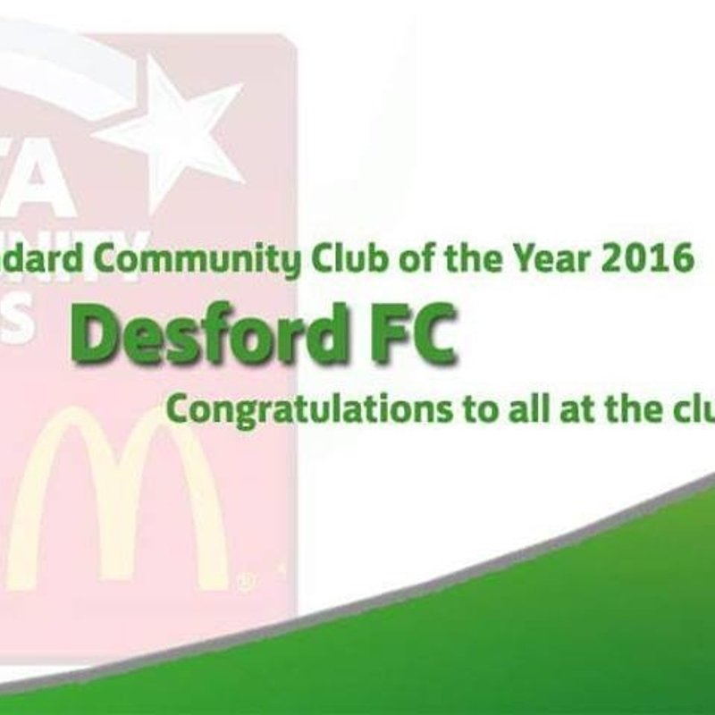 Simon Goodman collects community charter standard club of the year award on behalf of Desford FC