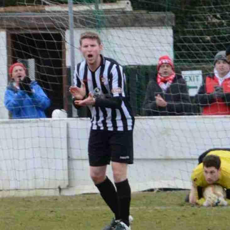 Town re-sign title winner Nick Rhodes