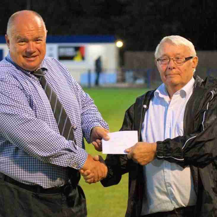 Fans hand over donation to heart campaign
