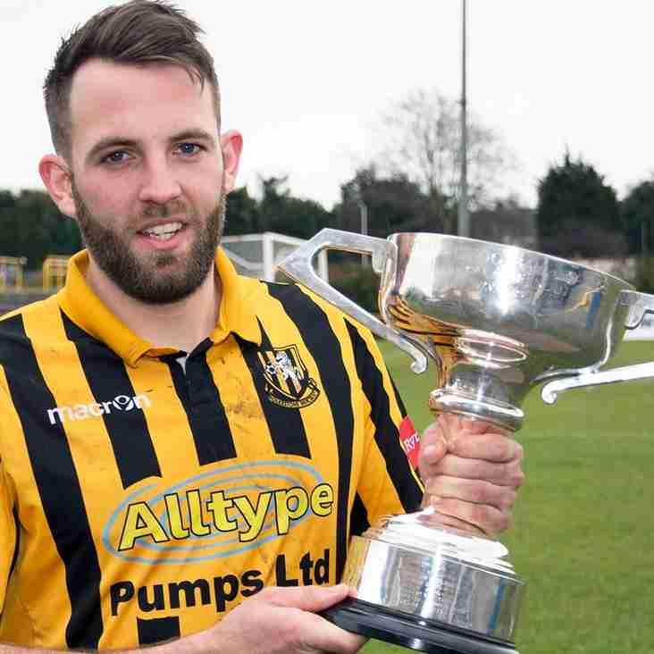 Champions honour veteran defender