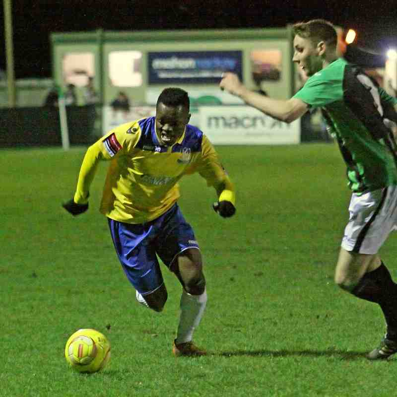 Enfield's Evans Kouassi (L) and Burgess Hill's Sam Fisk