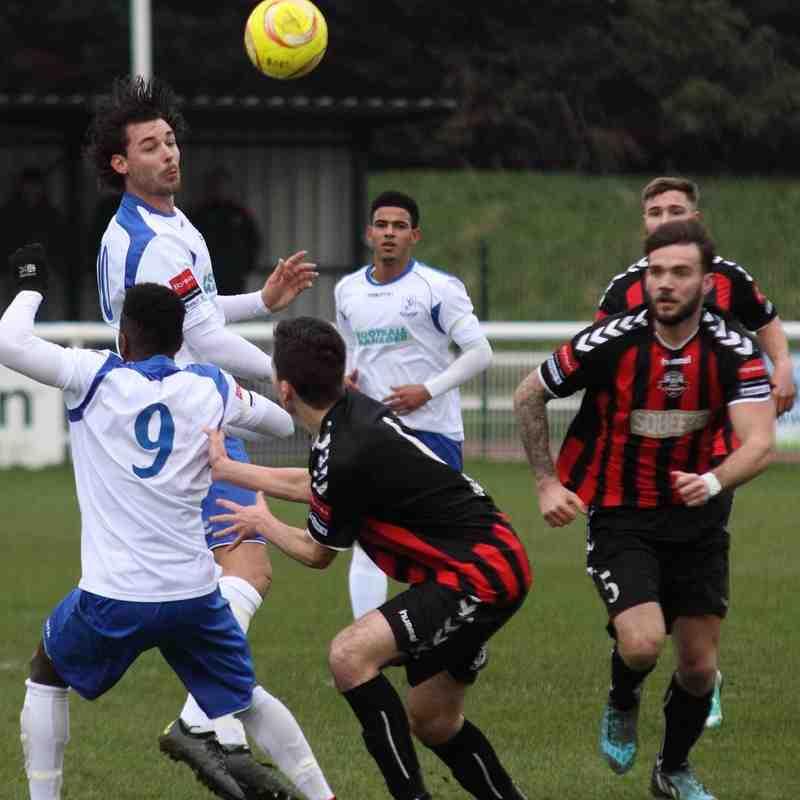 Enfield's Harry Ottaway heads the ball forward