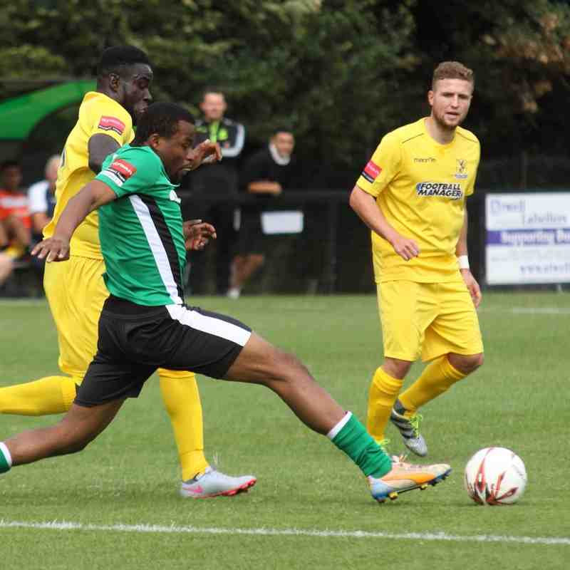 Burgess Hill's Cheik Toure (green) beats Kelvin Bossman to the ball as Billy Crook looks on