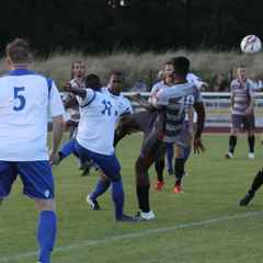 Town ease to first win