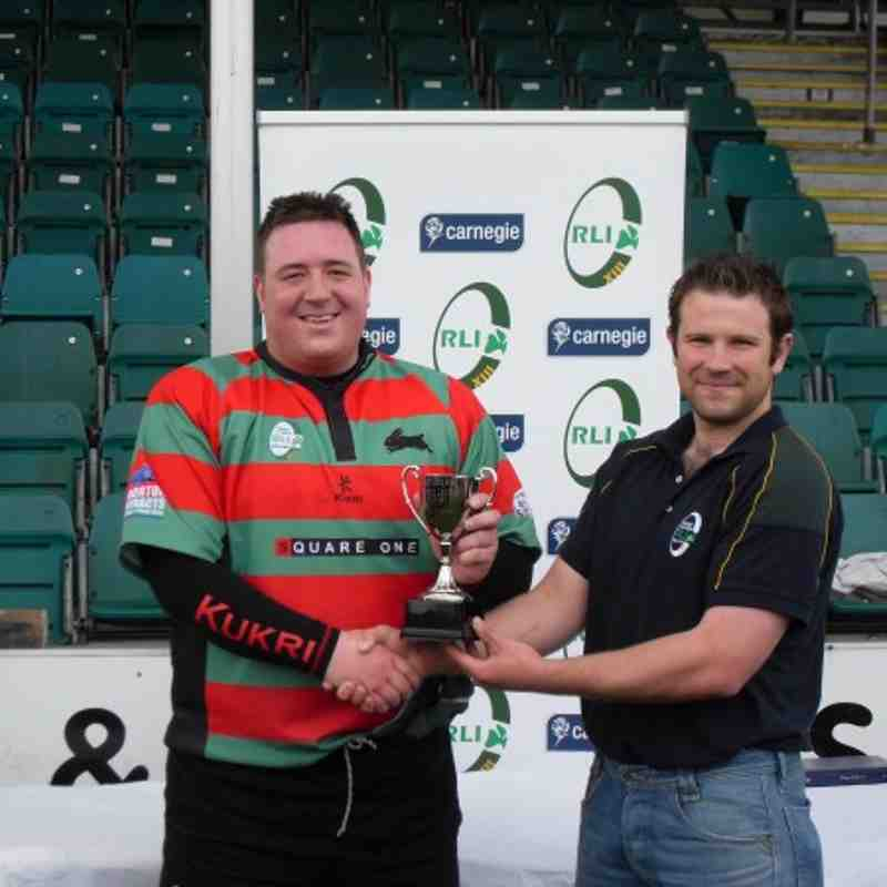 Tim Morton recieves the NI 9's trophy from RLI's Wayne Kelly