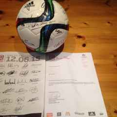 Football signed by Wales team on the night they qualified for Euros