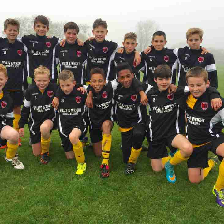 U13's in smart win wearing there new training tops