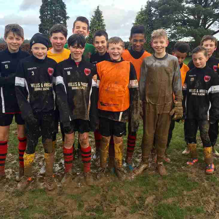 Under 13's enjoying the mud