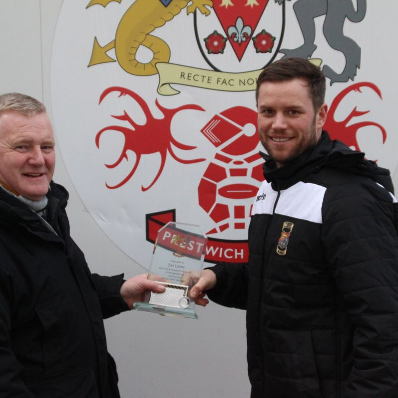 Heys present Lyons  with Club Milestone Award