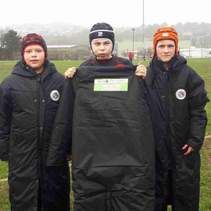 Falmouth Tyres Help U13s Stay Warm & Dry!