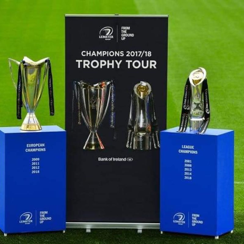 Pro 14 and Champions Cup trophies (and Leo)