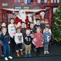 Santa arrives at G.F.C. Family Xmas Party