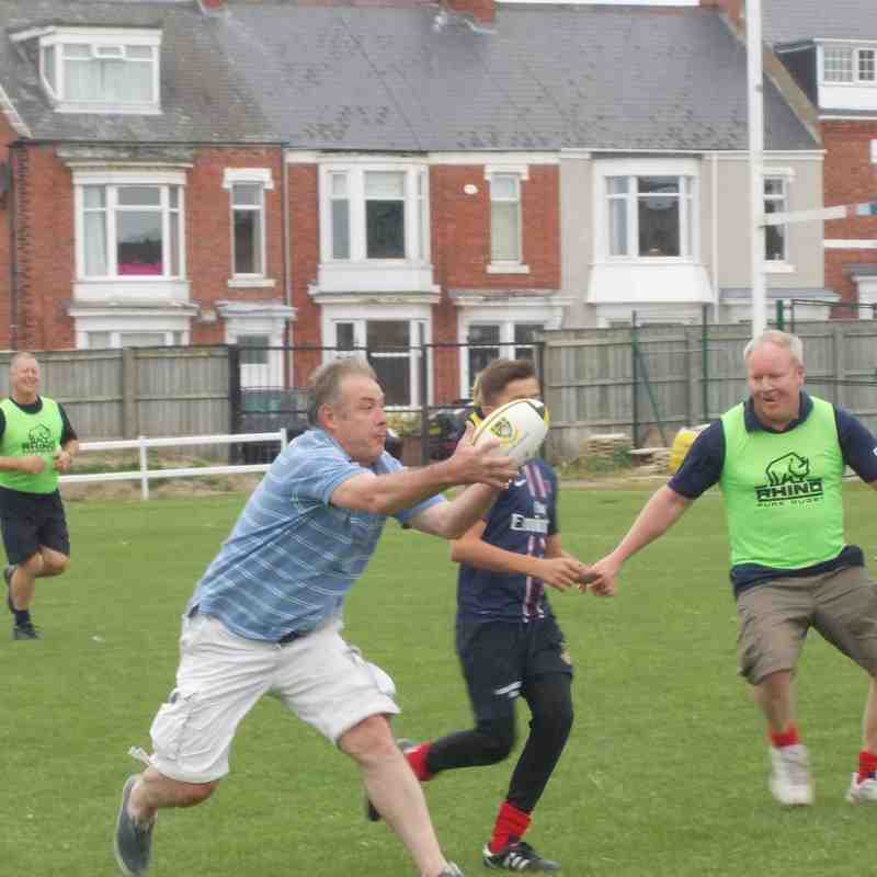 Aduts and kids touch rugby fun match
