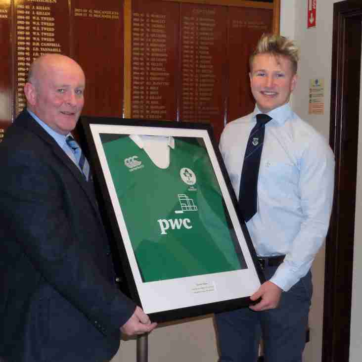 Former Player Stewart Moore Presents His Ireland Jersey to the Club