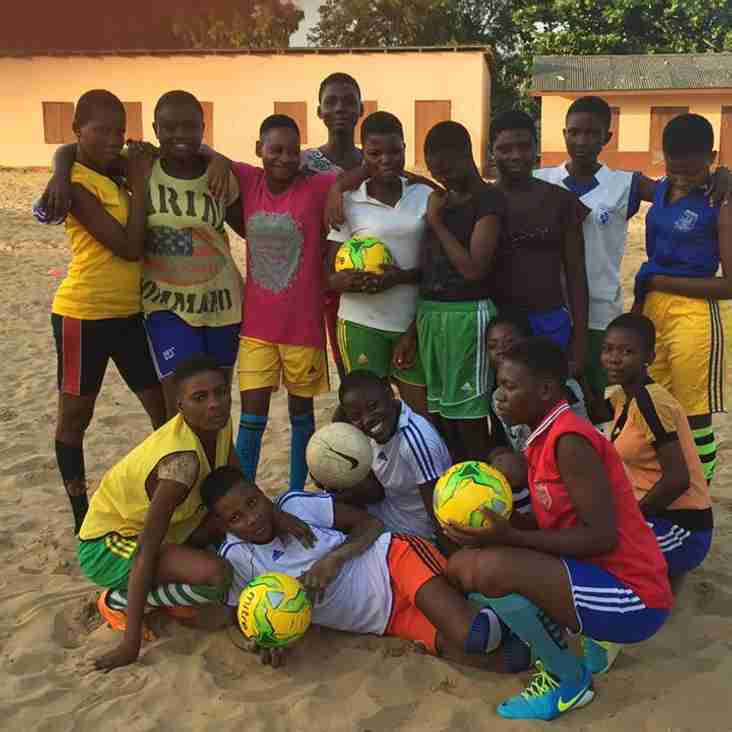 TOWN'S BOYS SEND BOOTS TO AFRICA