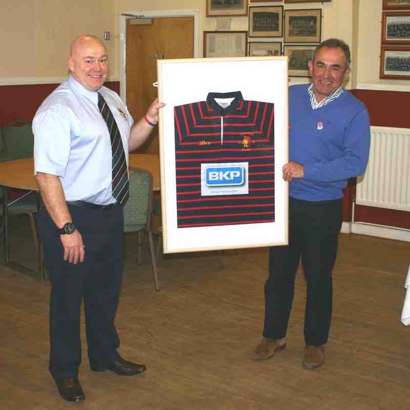 Mike Barns, Sponsorship Co-ordinator, presents framed shirts to our main sponsors