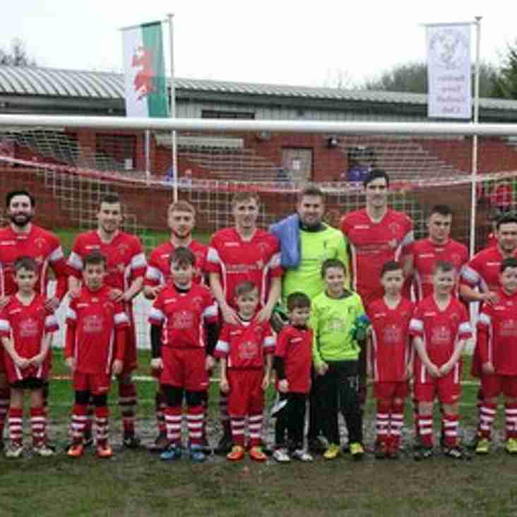 Buckley Juniors' U9s enjoy their day as mascots as they lead out the 1st team