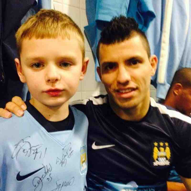 U8 Electrons player Harrison Swann as Manchester City Mascot