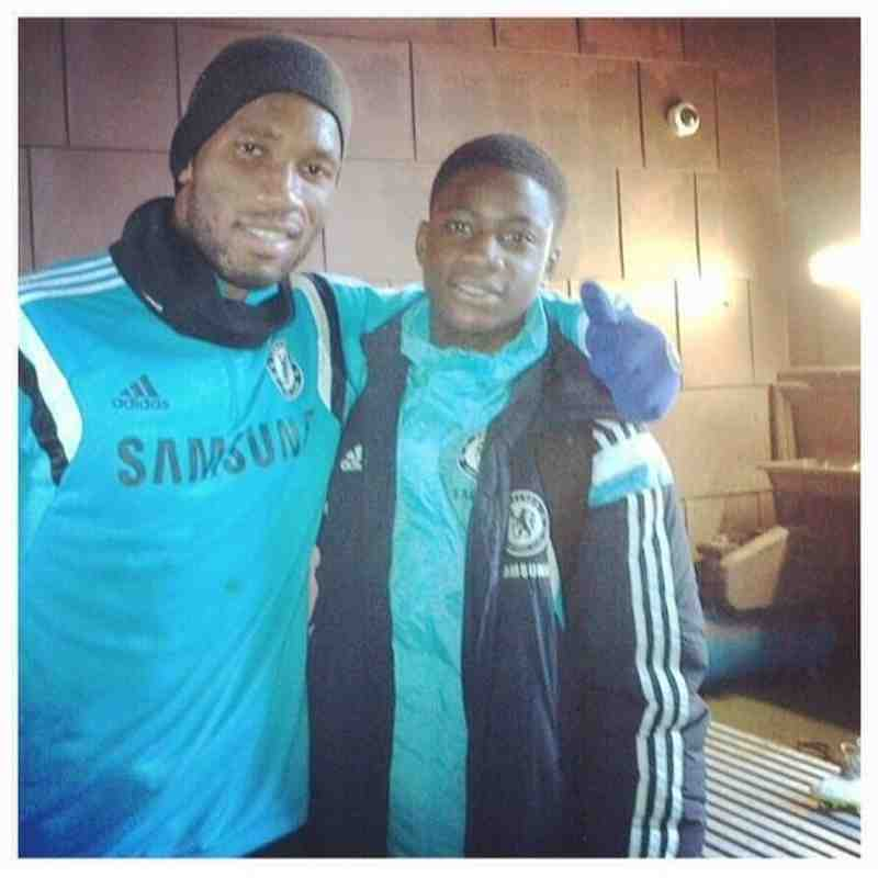 Clinton (U14 Midfielder) with Chelsea Forward Didier Drogba