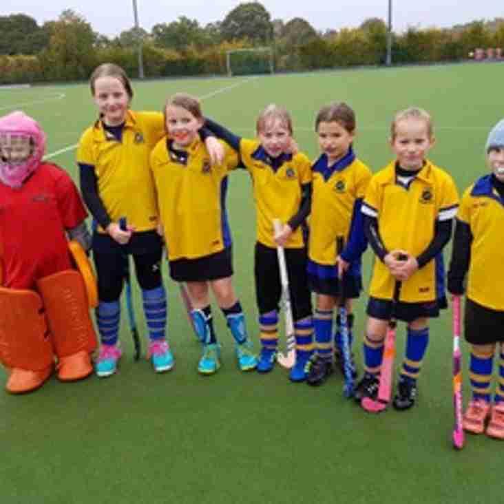 U10 Girls C team, wet but very cheerful.