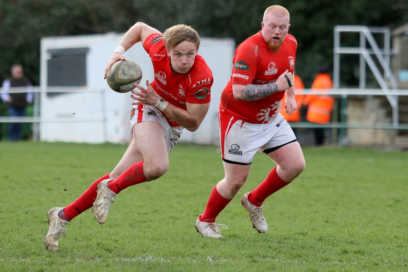 Nine try victory secures promotion