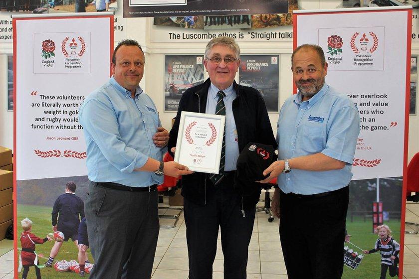 Alden Phillips receiving his Mitsubishi Motors Volunteer Recognition Award.