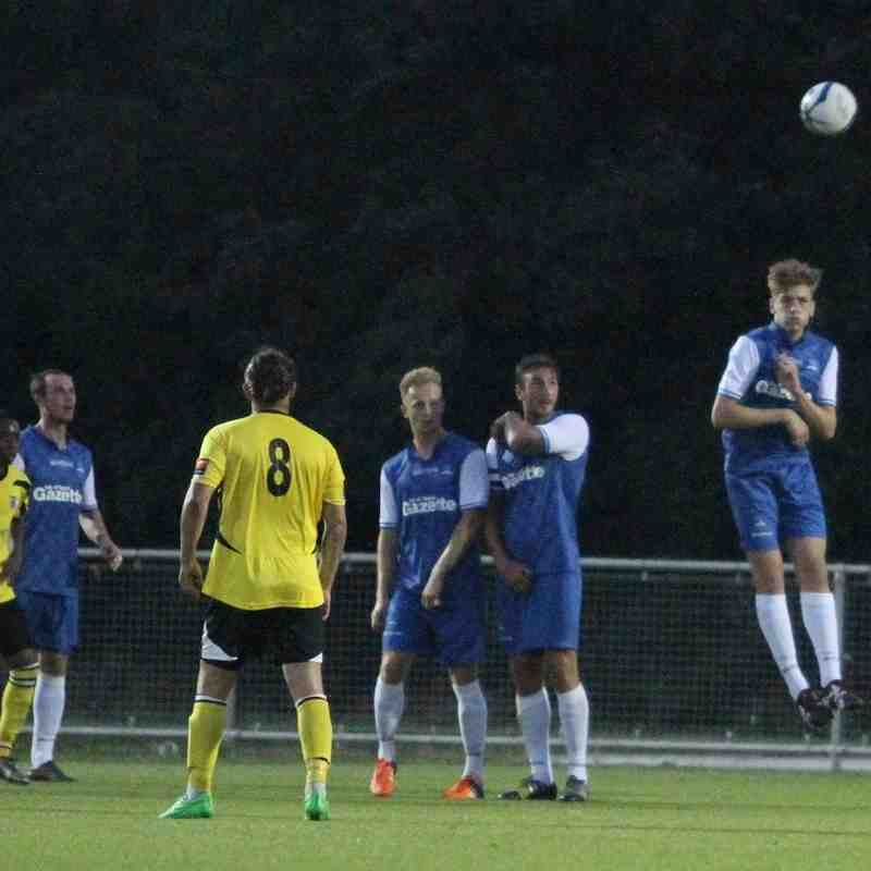 77 min. Faversham's free kick clears the Margate wall ....... and the goal ....... and the trees