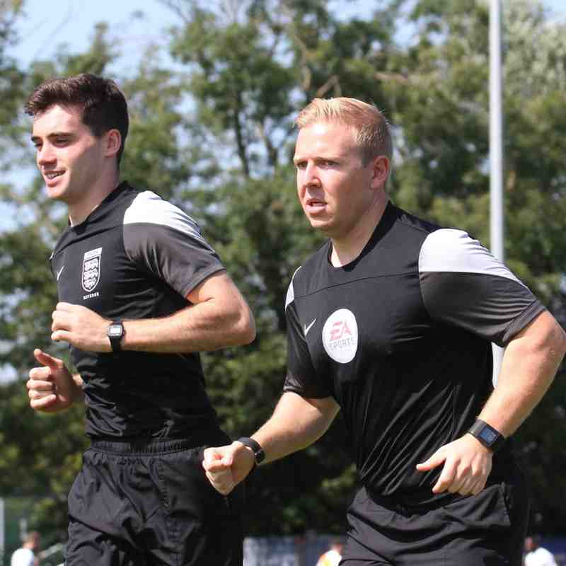 Two of today's officials in their pre-match warm-up