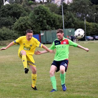 Town's new team draw in first friendly