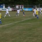 SIMEON'S ANGLED EFFORT ROLLS WIDE OF THE DAVENTRY GOAL...