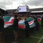 Ystradgynlais U12's shaking the Leicester Tigers flag for game Vs Wasps