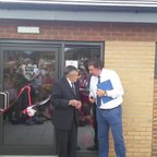 Jim Jones cutting the ribbon