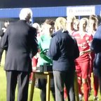 CALFC First Team players collect their County Cup Final winners medals