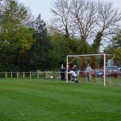 Action fron the village derby v Sarratt