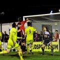 Ten men Town lose to last minute goal